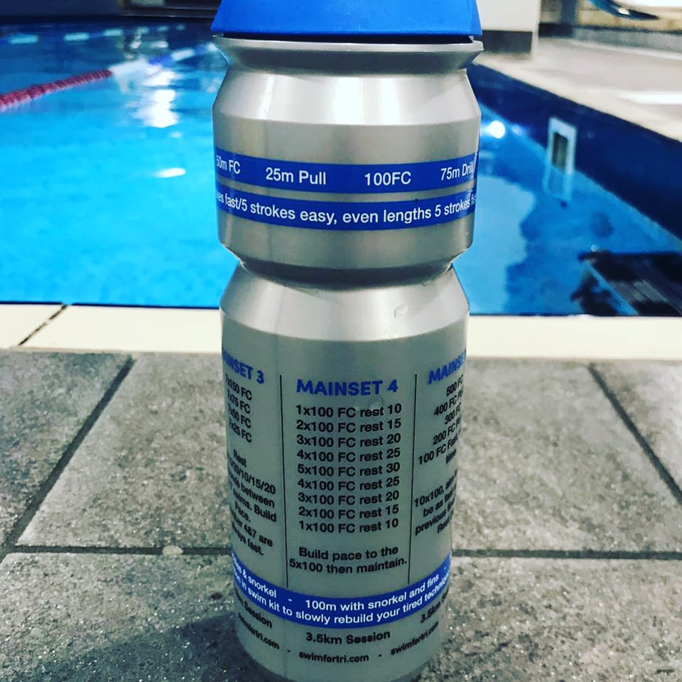 Training plan water bottle on pool side